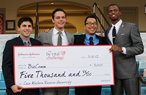 Weatherhead students who placed 2nd at Global Invitational hold giant check for $5,000