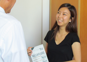First year MBA student receives book from donor