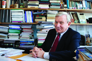 Gary Previts, Weatherhead accounting professor, among books and knick-nacs in his office