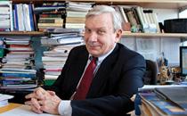Gary Previts sits at his desk
