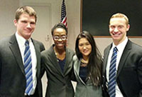 Four Case Western undergraduates stand together after taking 2nd place in Deloitte's Battle of Ohio.